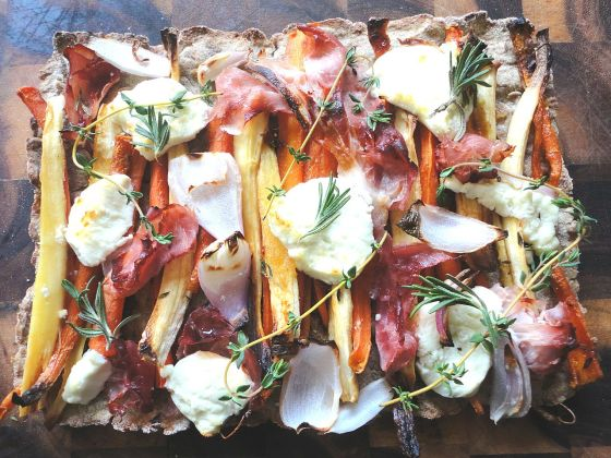 Root & prosciutto tart with goat cheese