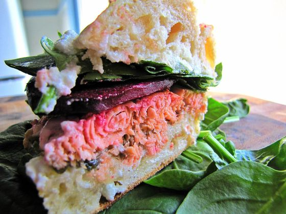 salmon, beet, goat cheese, spinach sandwich